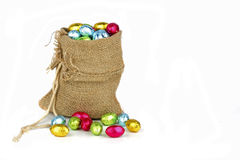 Bag full of easter chocolate eggs Royalty Free Stock Photos