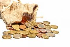 A bag full of euro money. Isolated on white stock photo
