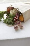 Bag full of fresh vegetables on table close-up Royalty Free Stock Photography