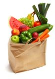 Bag full of healthy fruits and vegetables. A grocery bag full of healthy fruits and vegetables Stock Image