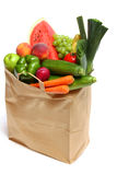 Bag full of healthy fruits and vegetables. A grocery bag full of healthy fruits and vegetables on white Royalty Free Stock Photos