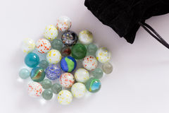 Bag full of various glass marbles. Royalty Free Stock Photography