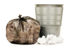 Bag with garbage and a basket stock photos