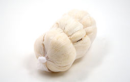 Bag of garlic isolated on white stock photography