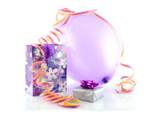Bag with gift, balloon and party streamer Stock Image