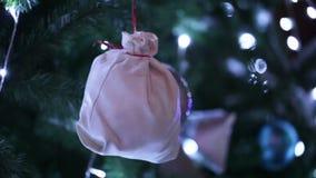 Bag for gift on Christmas tree stock footage