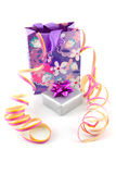 Bag with gift and party streamer Royalty Free Stock Photo