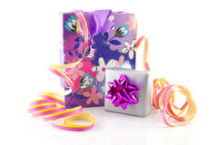 Bag with gift and party streamer Stock Photos
