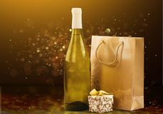 Gift bag with bottle of wine on festive background. Bag gift wine bottle table bar color Royalty Free Stock Photos