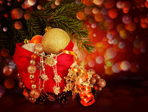 Bag with gifts and Christmas tree branches on an abstract backgr Stock Image