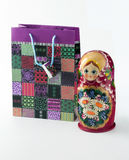 Bag of gifts and matryoshka Royalty Free Stock Photos
