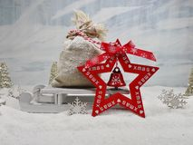 Bag of gifts on sledge and wooden heart  - The magic of Christmas Royalty Free Stock Image