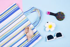 Bag, glasses, comb, hairpin and shell. Women`s trivia and summer bag. Going to the beach Stock Photo