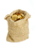 Bag with gold coins. Isolated on white background Stock Images