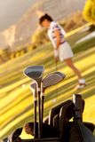 Bag of golf clubs outdoors Stock Photos