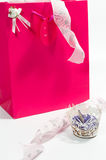 Bag of goodies with a cake Stock Photography