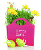 Bag with grass, flowers and Easter eggs Royalty Free Stock Photos