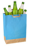 Bag with green beer. Bottles isolated on white background Royalty Free Stock Images