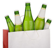 Bag with green beer. Bottles isolated on white background Royalty Free Stock Photography