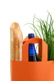 Bag with greens, baguette, and wine bottle Royalty Free Stock Images