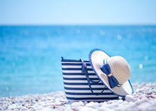 Bag and hat on the beach. Summer background royalty free stock images
