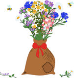 The bag with herbs - chamomile, angustifolium, cornflower, campanula, hypericum and bees Stock Photo