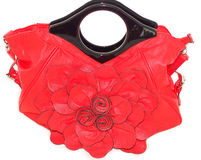 Bag ladies beautiful bright red on a white background. Women's handbags red with large flower front, kitsch style, sick floral design on a white background Royalty Free Stock Image