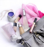 Bag lady. Make up and cosmetics in a bag woman Royalty Free Stock Photo