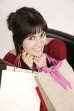 Happy Woman Holding Shopping Bags Pretty lady royalty free stock images