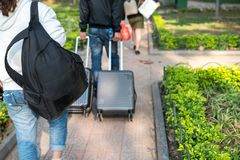 Bag or luggage of traveller walking in garden park.  Royalty Free Stock Image