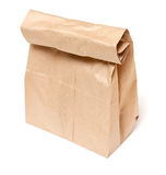 Bag lunch. Brown paper bag lunch on isolated white background royalty free stock photos