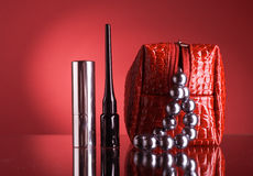 Bag for makeup and lipstick and mascara. Royalty Free Stock Photos