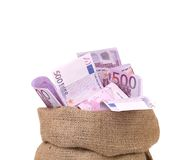 Bag with many euro banknotes. Isolated on a white background Stock Image