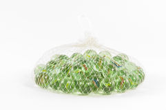 A bag of marbles. On white Royalty Free Stock Photos