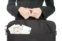 Bag with money. Black Bag with money in business woman hands stock images