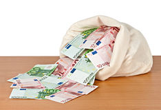 Bag with money. On desk Stock Images