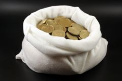 A bag with money. Against black background Stock Images