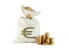Bag with money. And coins near on the white background stock images