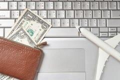 Bag money bills computer keyboard stock images