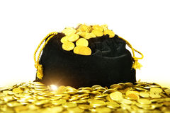A bag of money. Black bag with gold coins royalty free stock images