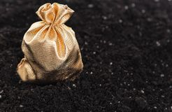 Bag of money is on the ground. Golden bag with the money on the ground royalty free stock image