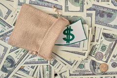 Bag of money on a pile. Money concept background. Top view stock photo