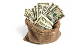 Bag with money. Studio photography of bag with hundred dollar bills stock images