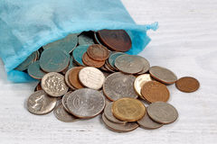 Bag of money on table Stock Photo