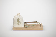 Bag with money in wooden mousetrap Stock Images