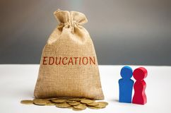 Bag of money and the word Education and family.The concept of education for yourself or children. Accumulation of money for study. Distribution of cash savings stock photo