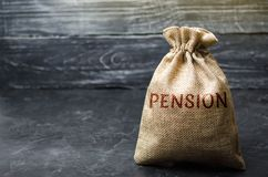 Bag with the money and the word Pension. Pension payments. Help from the state. Accumulation and saving money. Accumulation of royalty free stock photo