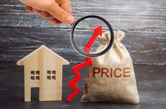 Bag with the money and the word Price and up arrow and wooden house. The increase in housing prices. Rising in fees for an. Apartment. The rise in property stock images