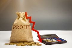 Bag with money and word profit and down arrow with calculator. Unsuccessful business and poverty. Profit decline. Loss of. Investment. Low wages. Economic stock photos