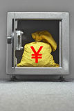 Bag of money with yen sign in open locker Royalty Free Stock Image